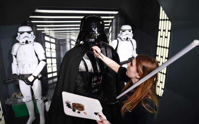 "A staff member of Madame Tussauds Berlin, prepares the waxwork replica of Darth Vader and Stormtrooper for the coming exhibition of ""Star Wars"" at Madame Tussauds Berlin in Berlin, Germany, 07 May 2015. The exhibition will open to the public on 12 May. (Photo by Jens Kalaene/EPA)"