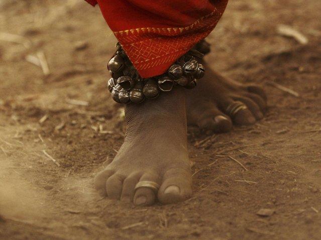 A member of Dongria tribe wearing traditional ornaments dances during the two-day long Niyamraja Festival atop of the Niyamgiri hills near Lanjigarh in Kalahandi district, Orissa state. (Photo by Biswaranjan Rout/AP Photo)