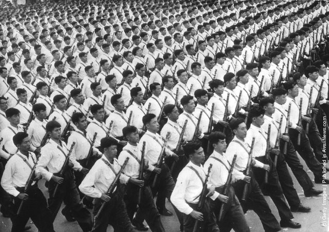1961: Lines of National Chinese Army marching in Peking with rifles