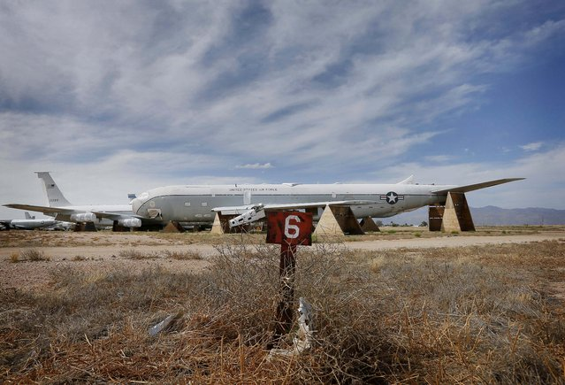 """The remains of a Boeing KC-135A Stratotanker, serial no. 55-3129, is stored at the 309th Aerospace Maintenance and Regeneration Group boneyard at Davis-Monthan Air Force Base in Tucson, Ariz. on Thursday, May 14, 2015. The aircraft is the original """"Weightless Wonder"""" of NASA according to the planes' records. NASA used the aircraft to train the Mercury 7 astronauts on zero-gravity flights, and it was nicknamed the """"Vomit Comet"""" for its effect on pilots and passengers alike. (Photo by Matt York/AP Photo)"""