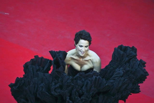 """Miss France 1992 Linda Hardy poses on the red carpet as she arrives for the screening of the animated film """"The Little Prince"""" (Le Petit Prince) out of competition at the 68th Cannes Film Festival in Cannes, southern France, May 22, 2015. (Photo by Vianney Le Caer/Reuters)"""