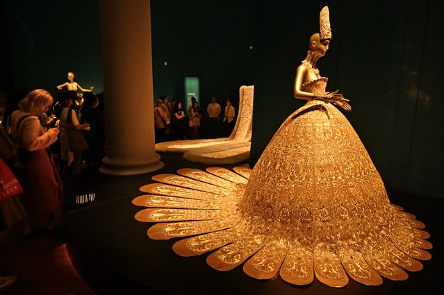"""A collection of embroidered dresses created by Chinese designer Guo Pei are displayed at the Asian Civilisations Museum during a preview of the exhibition, """"Guo Pei: Chinese Art and Couture"""" in Singapore on June 12, 2019. (Photo by Roslan Rahman/AFP Photo)"""