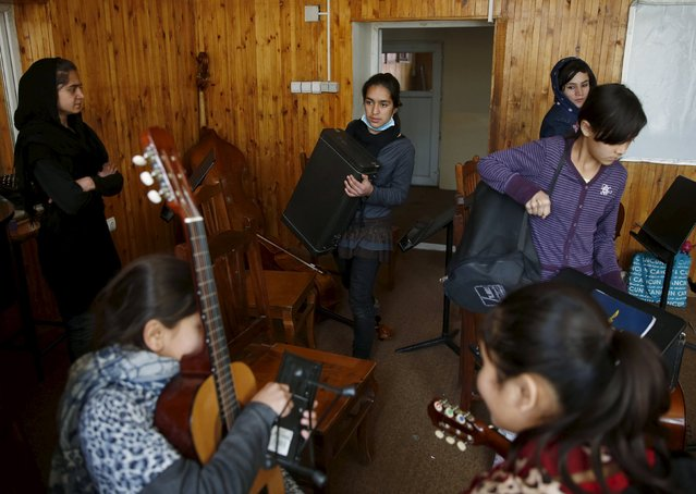 Members of the Zohra orchestra, an ensemble of 35 women, bring instruments to a class before a rehearsal at Afghanistan's National Institute of Music, in Kabul, Afghanistan April 4, 2016. (Photo by Ahmad Masood/Reuters)