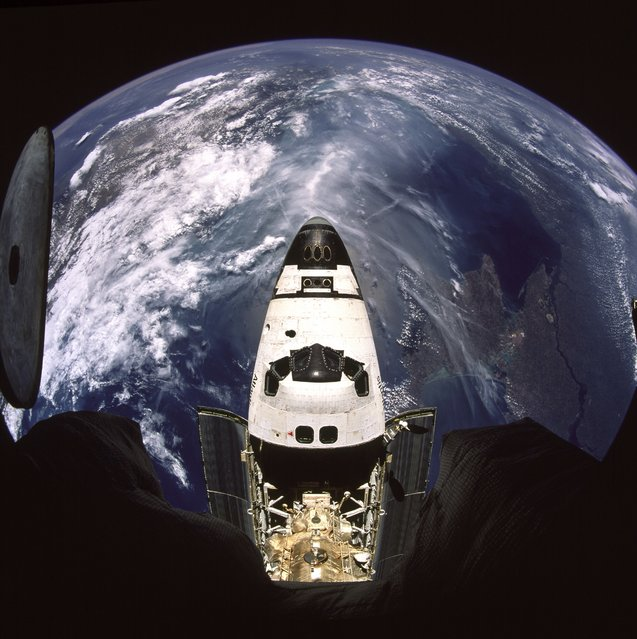 "Beautiful Earth and NASA's Space Shuttle Atlantis (STS-71), July 2, 1995, as seen from the Russian Federation ""Mir"" Space Station. (Photo by NASA)"