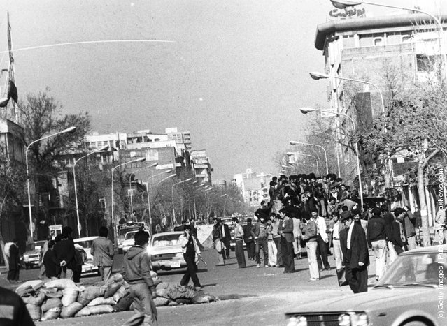 1979: Iranian demonstrators in the streets of Tehran during the revolt against the Shah