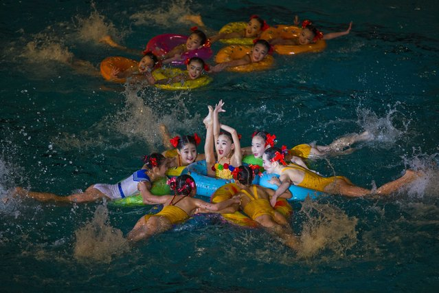 Young North Korean synchronized swimmers perform at an exhibition event in Pyongyang on Friday, February 15, 2013. (Photo by David Guttenfelder/AP Photo)