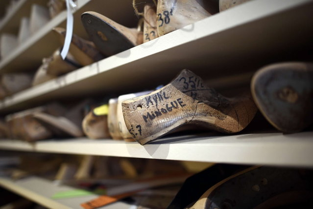 """This picture taken on April 22, 2014 in Paris, shows a form of shoe designed for Australian singer Kylie Minogue in the workshop of the """"Maison Clairvoy"""". Since 1945, the """"Maison Clairvoy"""" is specialised in the creation of luxury shoes and started in 1960 a collaboration with the famous Moulin Rouge to create boots and shoes for French Cancan dancers. (Photo by Franck Fife/AFP Photo)"""