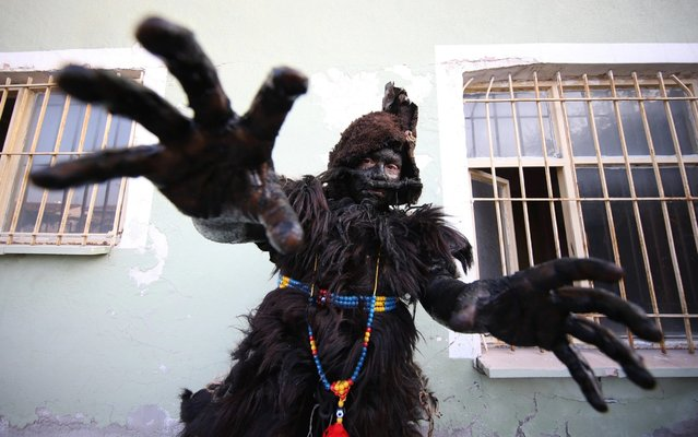 """A leather worker with his frightening types of clothes prepares after painted themselves using chimney soot as they participate in a programme within the September 6 celebrations, in Balikesir, Turkey on September 06, 2019. According to the story, """"Tulutabaklar"""" were painting themselves with ash and wearing goatskin or sheep skin to frighten the Greek soldiers occupying Balikesir during the National Struggle period. Every year on September 6, Tulutabaklar perform this ritual as part of the celebration of liberation of the city for 96 years. (Photo by Ali Atmaca/Anadolu Agency via Getty Images)"""