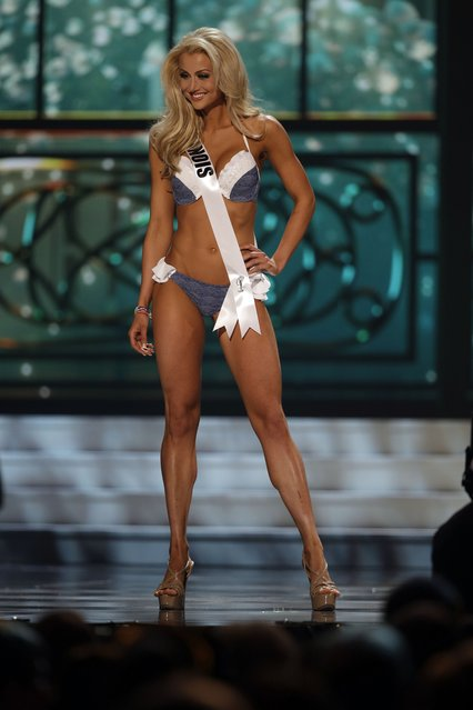 Miss Illinois, Renee Wronecki, competes in the bathing suit competition during the preliminary round of the 2015 Miss USA Pageant in Baton Rouge, La., Wednesday, July 8, 2015. (Photo by Gerald Herbert/AP Photo)