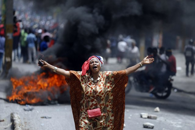 A protester yells anti-government slogans in Port-au-Prince, Haiti, Sunday, June 9, 2019. Protesters denouncing corruption paralyzed much of the capital as they demanded the removal of President Jovenel Moise. (Photo by Dieu Nalio Chery/AP Photo)