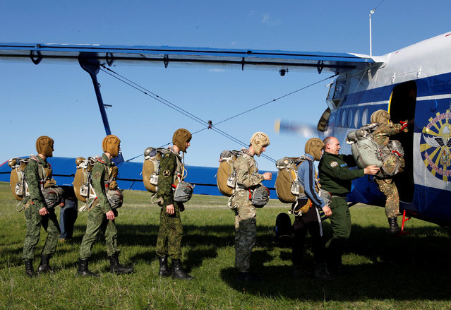 Students of the General Yermolov Cadet School board an airplane for a parachute jump at an airdrome in the village of Novomaryevskaya outside the southern city of Stavropol, Russia, May 13, 2016. (Photo by Eduard Korniyenko/Reuters)