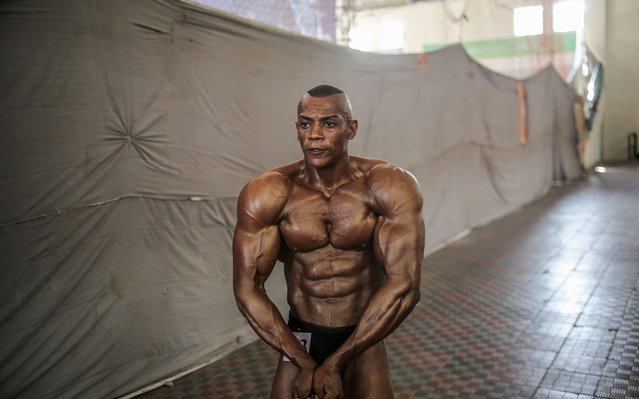 A Palestinian bodybuilder prepares before competing in a bodybuilding and fitness championship, in Gaza City, 15 September 2019. More than 70 gyms were established in the last 12 years in Gaza, as bodybuilding and fitness classes are reportedly attracting more Palestinian men and women in recent years. The local competition attracted dozen youths from the coastal enclave that is facing a blockade since 2007 and weekly protests near the Gaza-Israel border since March 2018. (Photo by Mohammed Saber/EPA/EFE)