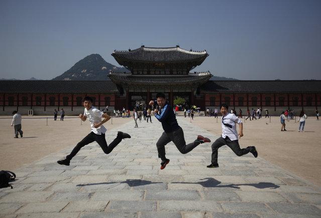 Students jump as they pose for photographs at Gyeongbok Palace in central Seoul May 14, 2014. (Photo by Kim Hong-Ji/Reuters)