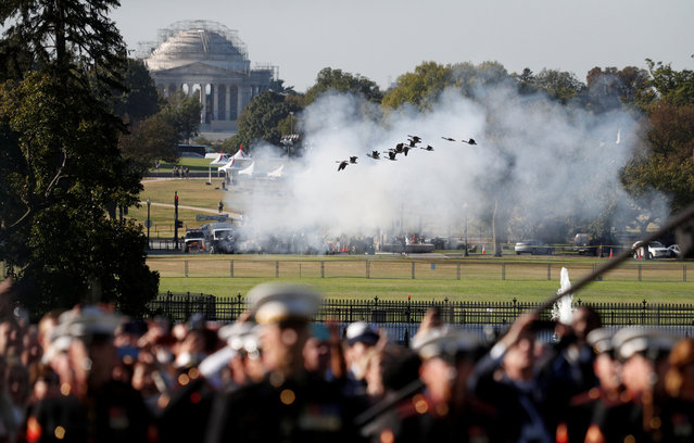 A flock of geese take flight over Washington's Ellipse in front of the Jefferson Memorial as guns are fired in a salute during an official arrival ceremony for Australia's Prime Minister Scott Morrison by U.S. President Donald Trump on the South Lawn of the White House in Washington, U.S., September 20, 2019. (Photo by Tom Brenner/Reuters)