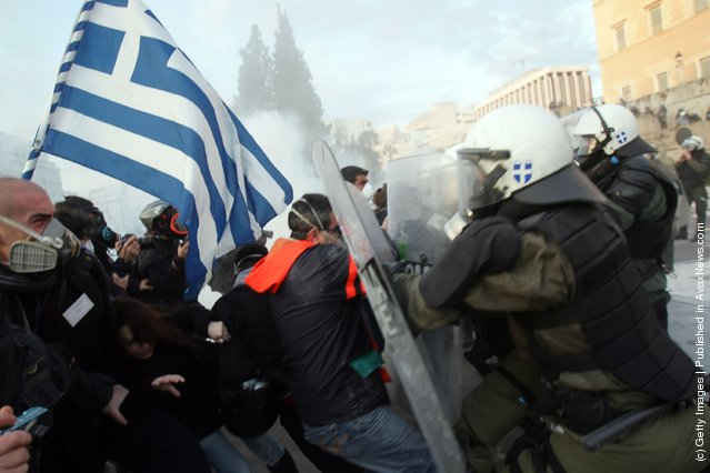 People clash with police in the streets during a demonstration against the new austerity measures on February 12, 2012 in Athens, Greece