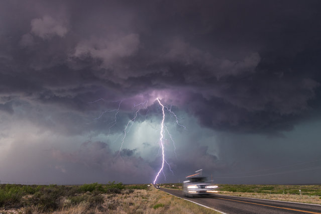 """Comin ta Getcha"". This image by Stu Short of storm chasers racing away from a monster supercell in New Mexico was among those to make the shortlist. (Photo by Stu Short/2019 Weather Photographer of the Year/RMetS)"