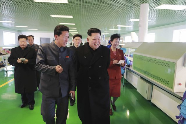North Korean leader Kim Jong Un (C) visits the Wonsan Shoes Factory in this undated photo released by North Korea's Korean Central News Agency (KCNA) in Pyongyang January 31, 2015. (Photo by Reuters/KCNA)