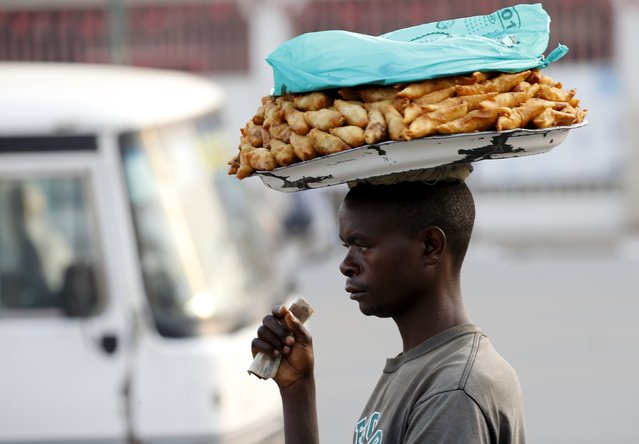 A man sells samoosas at a marketplace in Burundi's capital Bujumbura, as the country awaits the results of Tuesday's presidential elections, July 23, 2015. (Photo by Mike Hutchings/Reuters)