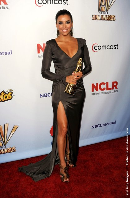 Actress Eva Longoria poses in the press room with the Favorite TV Show Award for Despirate Housewives during the 2011 NCLR ALMA Awards held at Santa Monica Civic Auditorium