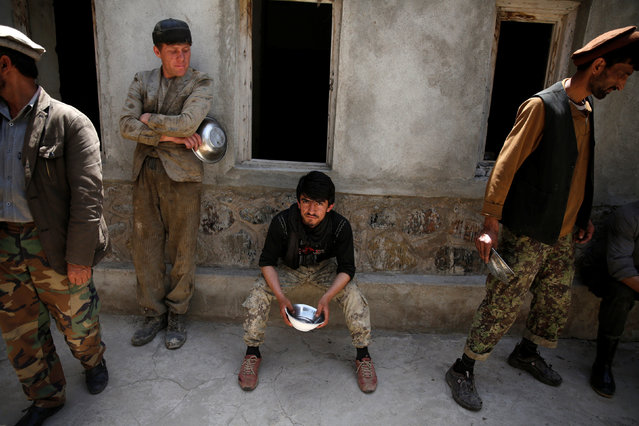 Workers wait for lunch at the Jabal Saraj cement factory in Jabal Saraj, north of Kabul, Afghanistan May 8, 2016. (Photo by Ahmad Masood/Reuters)