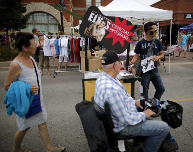A souvenir vendor sells programs during the four-day Collingwood Elvis Festival in Collingwood, Ontario July 25, 2015. (Photo by Chris Helgren/Reuters)