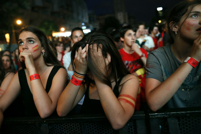 Spain supporters react as they watch the team's 2014 World Cup Group B soccer match against Netherlands on a giant screen at a fan park in Madrid, June 13, 2014. (Photo by Juan Medina/Reuters)