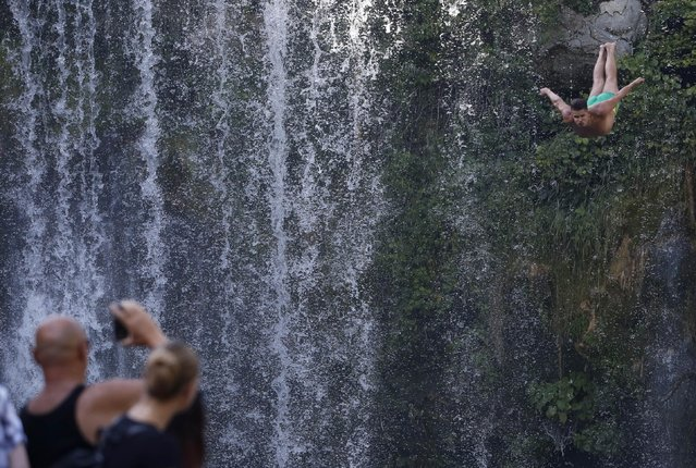 A competitor dives during the international waterfall jumping competition in the old town of Jajce, 250 kms west of Sarajevo, Bosnia, on Saturday, August 1, 2015. (Photo by Amel Emric/AP Photo)