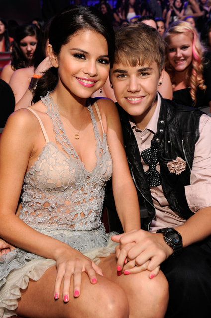 Singer/actress Selena Gomez and singer Justin Bieber attend the 2011 Teen Choice Awards at Gibson Universal Amphitheatre on August 7, 2011 in Universal City, California. (Photo by Kevin Mazur/TCA 2011/WireImage)
