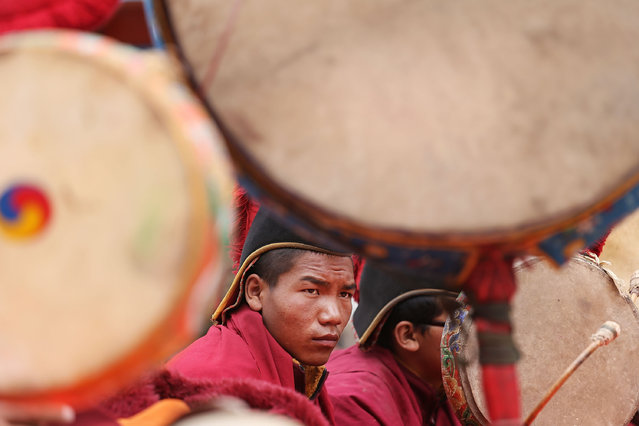 Monks chant and play music during the final day of ceremonies during the Tenchi Festival on May 27, 2014 in Lo Manthang, Nepal. The Tenchi Festival takes place annually in Lo Manthang, the capital of Upper Mustang and the former Tibetan Kingdom of Lo. Each spring, monks perform ceremonies, rites, and dances during the Tenchi Festival to dispel evils and demons from the former kingdom. (Photo by Taylor Weidman/Getty Images)