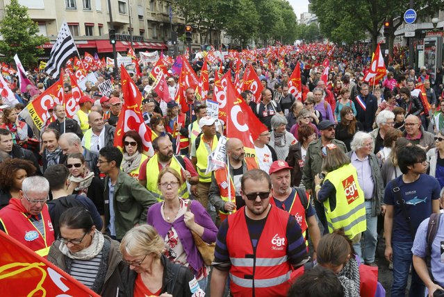 French CGT labour union employees march during a demonstration in Paris as part of nationwide protests against plans to reform French labour laws, France, June 14, 2016. (Photo by Jacky Naegelen/Reuters)
