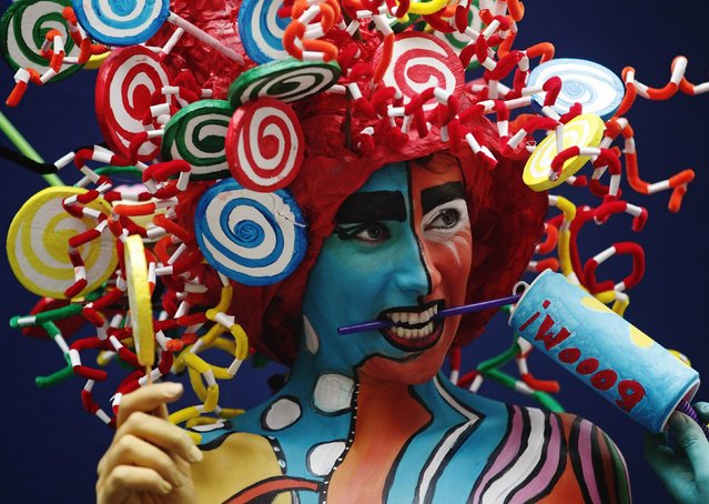 A model poses during the annual World Bodypainting Festival in Poertschach July 4, 2014. The event takes place from July 4 to 6 at lake Worthersee in Austria's southern Carinthia province. (Photo by Heinz-Peter Bader/Reuters)
