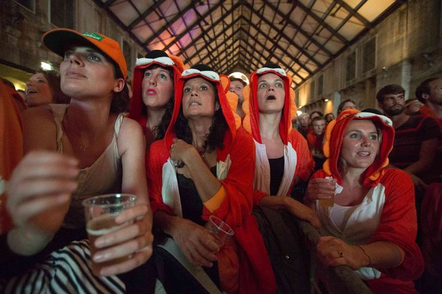 Dutch fans watch Netherlands' 2014 World Cup semi-final soccer match against Argentina, at a public screening in Amsterdam July 9, 2014. (Photo by Cris Toala Olivares/Reuters)
