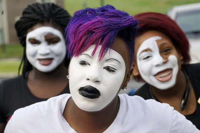 Georgia Haynes of the Mistory Dance Co. waits before a protest march in Ferguson, Missouri August 8, 2015. (Photo by Rick Wilking/Reuters)
