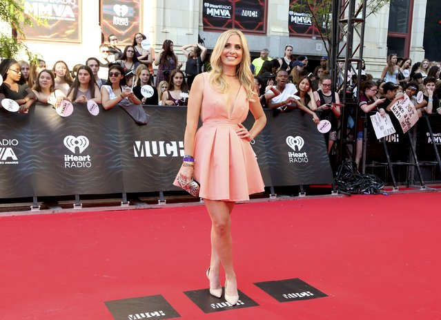 Virgin Radio host Andrea Collins arrives for the iHeartRadio Much Music Video Awards (MMVAs) in Toronto, Ontario, Canada June 19, 2016. (Photo by Peter Power/Reuters)