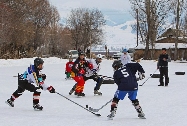 Young hockey players are seen in action during a training match between Kyrgyzstan's first female hockey team and the male team of the Karakol lyceum, in the village of Otradnoye, Kyrgyzstan on February 4, 2020. (Photo by Vladimir Pirogov/Reuters)