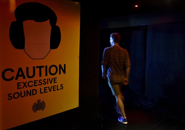 """A club-goer arrives at """"Morning Gloryville"""" at the Ministry of Sound in south London August 11, 2015. (Photo by Toby Melville/Reuters)"""