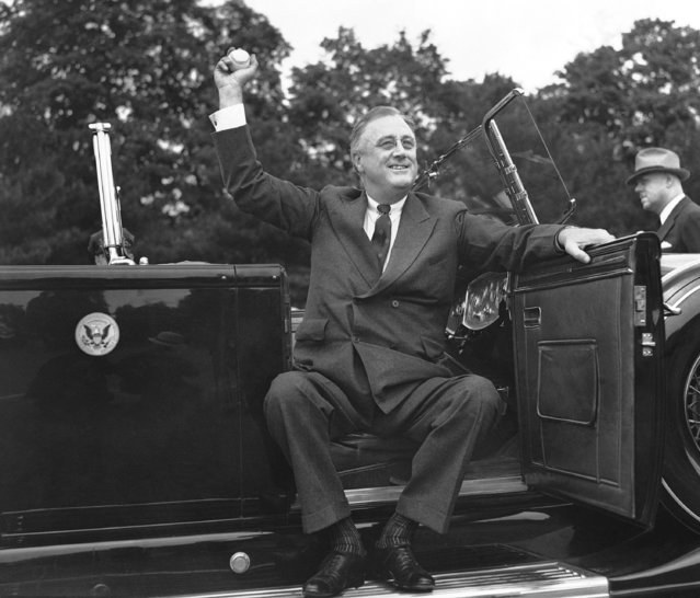 President Franklin D. Roosevelt, spending the weekend at his Hyde Park home, went to the ball game between the Hyde Park Robin Hoods with whom he once played, and Columbiaville. From his automobile he tossed out the first ball to open the game, May 24, 1936. (Photo by George R. Skadding/AP Photo)