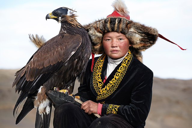 Asholpan is the 13-year-old daughter of a legendary Kazakh eagle hunter. Asholpan may well be the only female eagle hunter in the world among the 70 that remain. (Photo by Tariq Zaidi/The Washington Post)