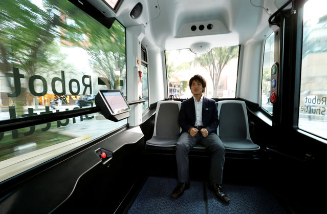 An employee of Japan's internet commerce and mobile games provider DeNA Co, rides on the company's Robot Shuttle, a driver-less, self driving bus, during its demonstration in Tokyo, Japan July 7, 2016. (Photo by Toru Hanai/Reuters)