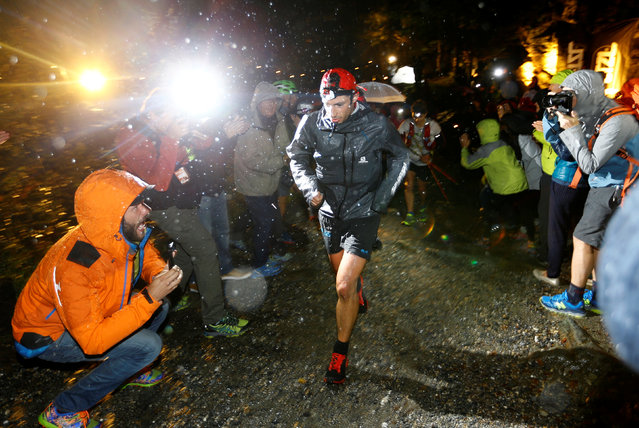 Second- placed Spanish athlete and former Mount Blanc Ultra Trail (UTMB) winner, Kilian Jornet, is cheered on by spectators during the 15 th edition of the Mount Blanc Ultra Trail on September 1, 2017 near Chamonix. (Photo by Denis Balibouse/Reuters)
