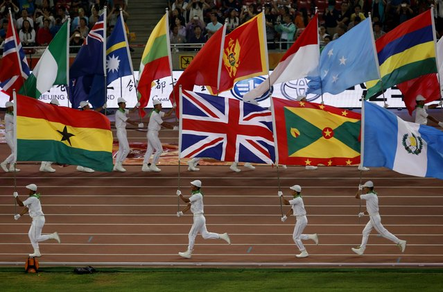 Flagbearers take part in the closing ceremony of the 15th IAAF Championships at the National Stadium in Beijing, China August 30, 2015. (Photo by Fabrizio Bensch/Reuters)