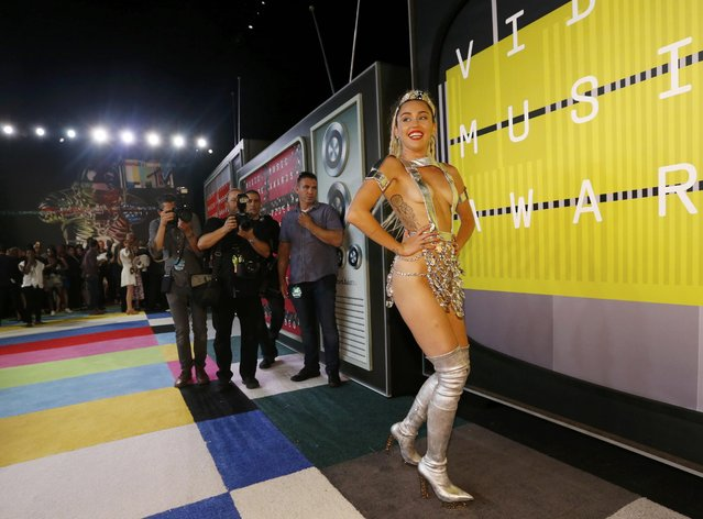 Show host Miley Cyrus poses as she arrives at the 2015 MTV Video Music Awards in Los Angeles, California August 30, 2015. (Photo by Mario Anzuoni/Reuters)
