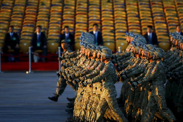 Soldiers of the People's Liberation Army (PLA) of China march in formation past the Tiananmen Square before a military parade to mark the 70th anniversary of the end of World War Two, in Beijing, China, September 3, 2015. (Photo by Damir Sagolj/Reuters)