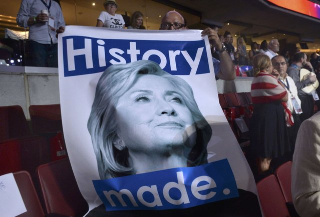 A delegate holds a Hillary Clinton poster at the Democratic National Convention in Philadelphia, Pennsylvania. U.S. July 28, 2016. (Photo by Charles Mostoller/Reuters)