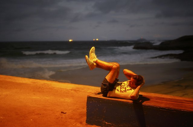 Local works out on Praia do Diabo (Devil's Beach) in Rio de Janeiro, Brazil on July 30, 2016. (Photo by Nacho Doce/Reuters)