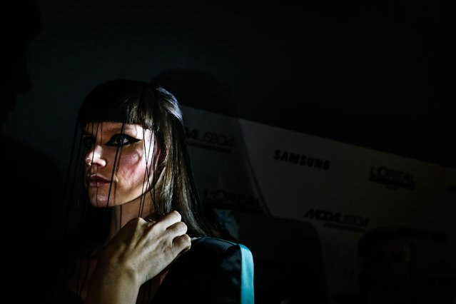 A model wears a creation by Portuguese designer Dino Alves as she is prepared backstage during the Lisbon Fashion Week, at the Carlos Lopes Pavillion, in Lisbon, Portugal, 07 October 2017 (issued 08 October 2017). Spring/Summer 2018 collections are presented at the ModaLisboa from 05 to 08 October. (Photo by Rodrigo Antunes/EPA/EFE)