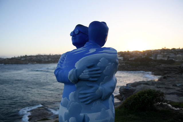 """The installation """"Under One Sky"""" by Stephan Marr at Sculpture By The Sea at Bondi Beach on October 18, 2017 in Sydney, Australia. """"A fusion of painting, sculpture and storytelling. In this era of global conflict, I have created a work of goodwill. Two people greet in an embrace bridging race, creed and nationality"""". (Photo by Dean Lewins/AAP)"""
