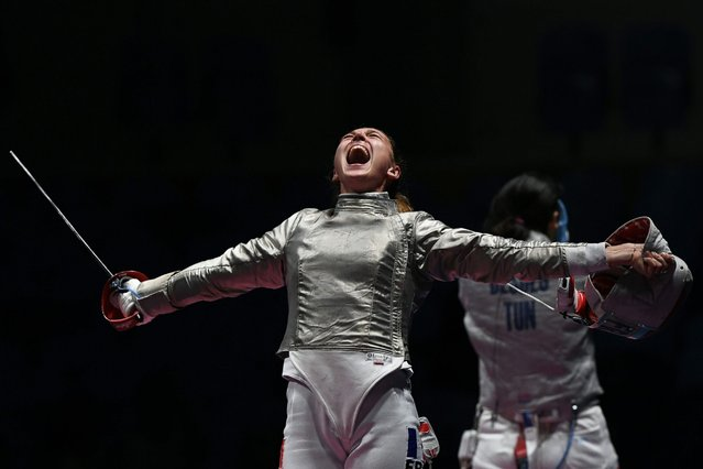 France's Manon Brunet celebrates winning against Tunisia's Azza Besbes in their womens individual sabre quarter-final bout as part of the fencing event of the Rio 2016 Olympic Games, on August 8, 2016, at the Carioca Arena 3, in Rio de Janeiro. (Photo by Kirill Kudryavtsev/AFP Photo)