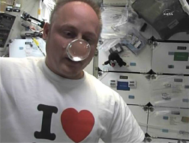 Space Shuttle Endeavour astronaut Mike Fincke plays with a water bubble in microgravity aboard the International Space Station on May 29, 2011. (Photo by Reuters/NASA TV)