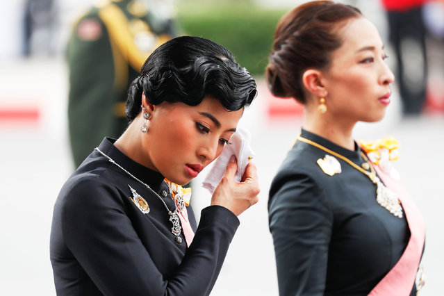 Thai Princess Bajrakitiyabha (R) and Princess Sirivannavari Nariratana take part in the funeral procession for the late Thai king Bhumibol Adulyadej in Bangkok on October 26, 2017 A sea of black- clad mourners massed across Bangkok' s historic heart early on October 26 as funeral rituals began for King Bhumibol Adulyadej, a revered monarch whose passing after a seven- decade reign has left Thailand bereft of its only unifying figure. (Photo by Damir Sagolj/Reuters)